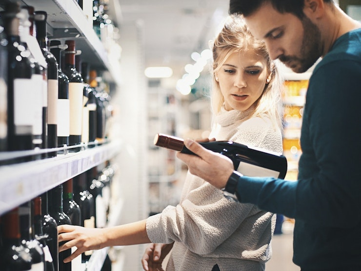 Couple Buying Some Wine At A Supermarket Med