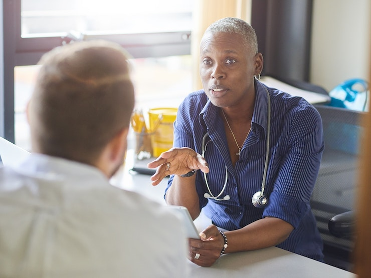 Doctor Chatting To Male Patient Med