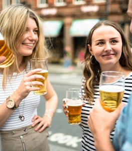 Group Of Friends Toasting With Drinks For The Oktoberfest Istock 600410406