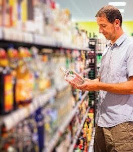 Man In Supermarket In Alcohol Aisle Istock 530876175