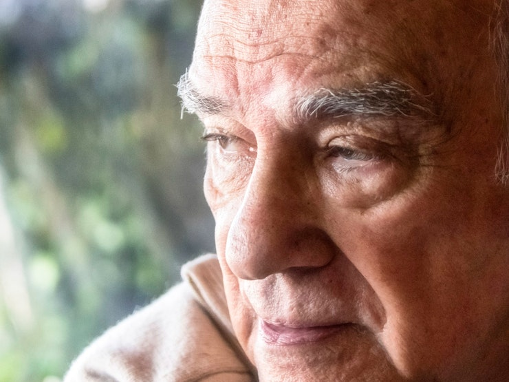 Pensive Hispanic Senior Man Looking Away Istock 954007508