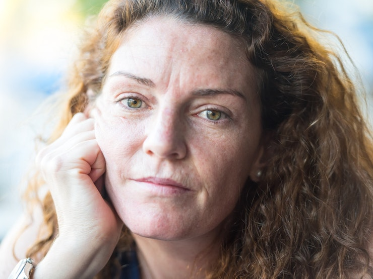Pensive Mature Woman Looking Straight At Camera Istock 594017434