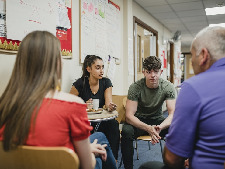 Teenagers Group Therapy At The Community Centre Stock Photo