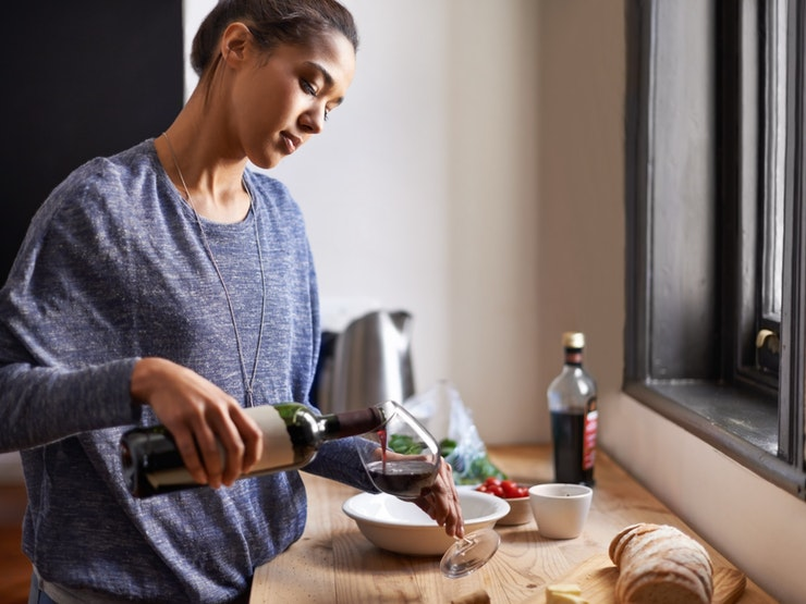 Topping Up Her Wine Glass Istock 454331767