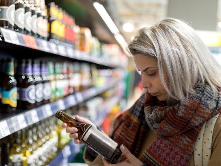 Woman looking at label 2