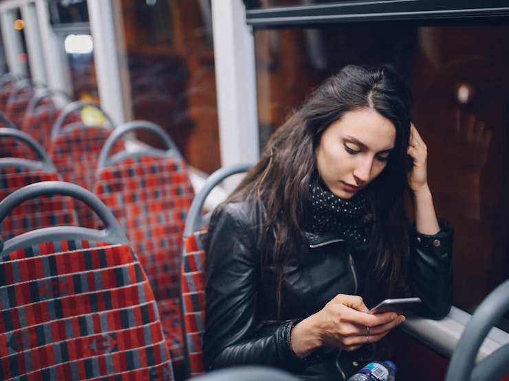 Young Woman Texting While Riding On The Bus In London At Night Istock 863278646